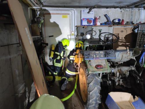 Öffnen der Brandraumtür mit Hitzekontrolle